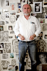 Brice Bowman Standing in front of drawings